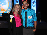 NWA Democrat-Gazette/CARIN SCHOPPMEYER Angela Courage, scholarship fund alumna, and her son Sam Berios stand for a photo at Spark of Hope.