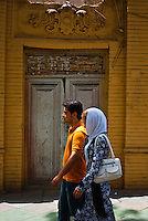 Iranian couple walking on Vali-asr avenue.