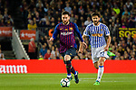 Lionel Messi of FC Barcelona (L) runs with the ball during the La Liga match between Barcelona and Real Sociedad at Camp Nou on May 20, 2018 in Barcelona, Spain. Photo by Vicens Gimenez / Power Sport Images