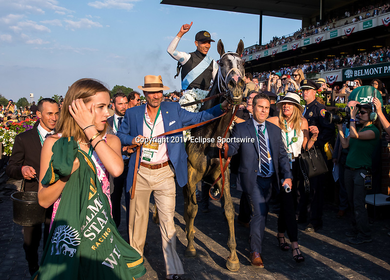 ELMONT, NY - JUNE 10: Tapwrit #2, ridden by Jose Ortiz, is led to the winner's circle after winning the 149th Belmont Stakes on Belmont Stakes Day at Belmont Park on June 10, 2017 in Elmont, New York (Photo by Jesse Caris/Eclipse Sportswire/Getty Images)