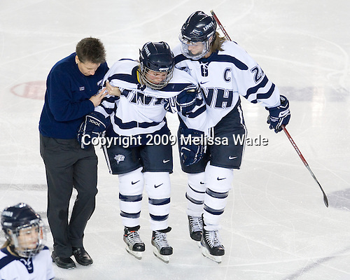 Kelly Cahill (UNH - 4), Kacey Bellamy (UNH - 22) - The University of Minnesota-Duluth Bulldogs defeated the University of New Hampshire Wildcats 4-1 in their NCAA Quarterfinal meeting on Saturday, March 14, 2009, at the Whittemore Center in Durham, New Hampshire.