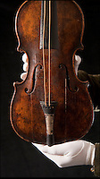 BNPS.co.uk (01202 558833)<br /> Pic: Phil Yeomans/BNPS<br /> <br /> And the band played on...<br /> <br /> The historic violin that was famously played as the Titanic sank has been sold at auction in Devizes for &pound;1.1 million.<br /> <br /> The wooden instrument has been proven to be the one used by Wallace Hartley as his band famously played on to help keep the passengers calm during the disaster.<br /> <br /> Its existence and survival only emerged in 2006 when the son of an amateur violinist who was gifted it by her music teacher in the early 1940s contacted an auctioneers.