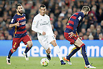FC Barcelona's Arda Turan (l) and Gerard Pique (r) and Real Madrid's Cristiano Ronaldo during La Liga match. April 2,2016. (ALTERPHOTOS/Acero)