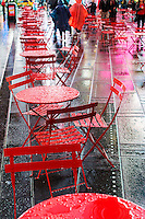 No one is sitting on the wet tables and chairs in a Times Square pedestrian plaza in New York on a rainy Tuesday, June 2, 2015 evening. (© Richard B. Levine)