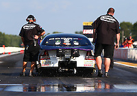 Aug. 16, 2013; Brainerd, MN, USA: Crew members for NHRA pro stock driver Vincent Nobile during qualifying for the Lucas Oil Nationals at Brainerd International Raceway. Mandatory Credit: Mark J. Rebilas-
