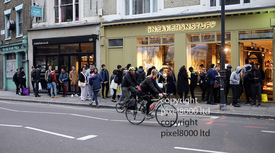 Pic shows: Huge queue outside a training shoe store in Shoreditch last night.<br /> Sneakerstuff was giving people the chance to buy the new Kanye West  designed trainers. Adidas Yeezy boost 750 due out tomorrow 15.10.16<br /> If you queued long enough you got given a raffle ticket. This ticket went into a draw for the possible hundred pair of shoes they might to sell.<br /> According to one punter you had to pay £250 for the new shoes but could then possibly sell them on ebay for £800.<br /> The reason for the raffle is the shop does not want people camping up outside the shop for days and blocking the pavements such is the demand.<br /> <br /> <br /> <br /> <br /> Pic by Gavin Rodgers/Pixel 8000 Ltd