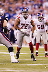 New York Giants defensive lineman Osi Umenyiora (72) plays defense during the NFL Super Bowl XLVI football game against the New England Patriots on Sunday, Feb. 5, 2012, in Indianapolis. The Giants won 21-17 (AP Photo/David Stluka)...