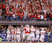Ohio State Buckeyes running back Ezekiel Elliott (15) celebrates his touchdown in the first quarter of the Big Ten Championship game at Lucas Oil Stadium in Indianapolis on Saturday, December 6, 2014. (Columbus Dispatch photo by Jonathan Quilter)