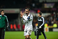 Thursday 28 November  2013  Pictured: Leon Britton applauds as he leaves the field<br /> Re:UEFA Europa League, Swansea City FC vs Valencia CF  at the Liberty Staduim Swansea