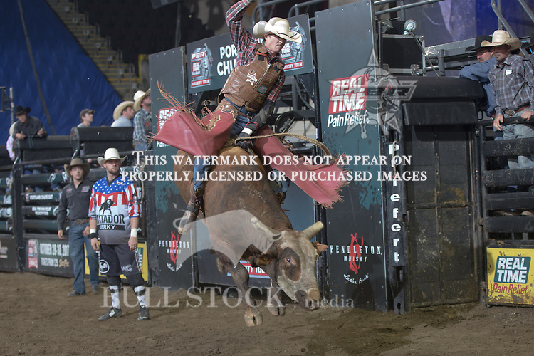 Landon Hinkle  attempts to ride  Peep Show ( Triple R Bull Co. ) during the first round of the PBR Real Time Pain Relief Velocity Tour event in  Portland, ME - Photo by Andre Silva