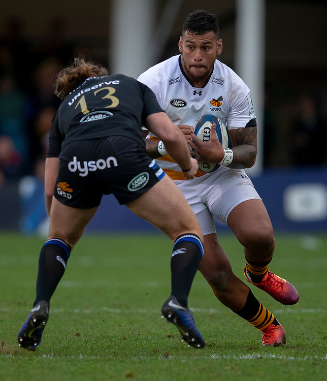 Wasps' Nathan Hughes is tackled by Bath Rugby's Max Clark<br /> <br /> Photographer Bob Bradford/CameraSport<br /> <br /> European Rugby Heineken Champions Cup Pool 1 - Bath Rugby v Wasps - Saturday 12th January 2019 - The Recreation Ground - Bath<br /> <br /> World Copyright © 2019 CameraSport. All rights reserved. 43 Linden Ave. Countesthorpe. Leicester. England. LE8 5PG - Tel: +44 (0) 116 277 4147 - admin@camerasport.com - www.camerasport.com
