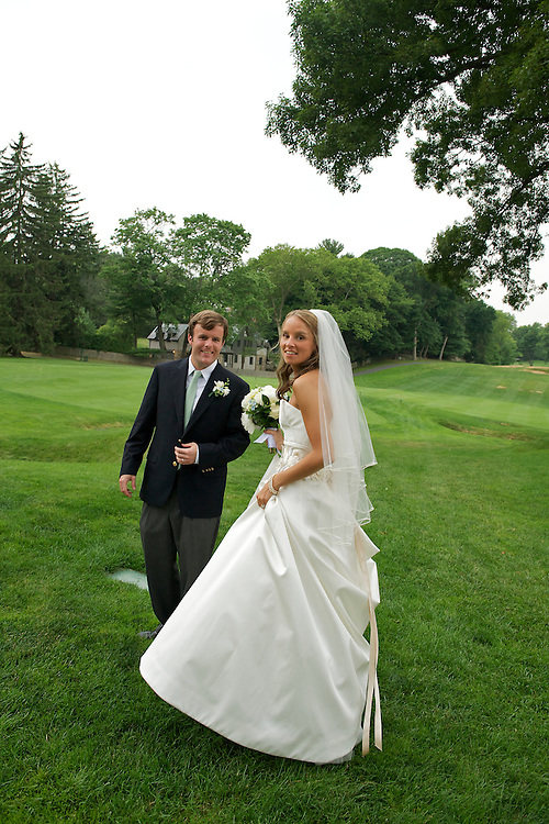 Full length shot of bride and groom on the golf course at Apawamis Country Club, Rye, NY