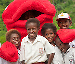 A Red Snapper mascot pays a visit to Lobo Village, getting school kids jazzed about conservaion in Triton Bay, Papua.