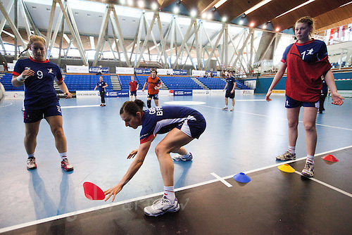 06 APR 2012 - LONDON, GBR - Daniela Sposi (second from left) grabs a cone during a training game for the Great Britain women's handball team at the National Sports Centre in Crystal Palace, Great Britain (PHOTO (C) 2012 NIGEL FARROW)