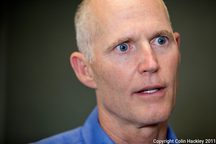 TALLAHASSEE, FLA. 7/28/11-SCOTTRADIO HACKLEY11-Gov. Rick Scott talks with the media after appearing on a gospel radio talk Thursday in Tallahassee. Recently Scott has been appearing on talk radio across the state several times a day as a way to get his message out to Floridians..COLIN HACKLEY PHOTO
