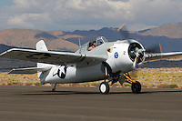 Tom Camp taxies a General Motors built FM-2 Wildcat along the ramp at Stead Field, Nevada. Grumman Aircraft originally designed the plane in 1935 and was the first all-metal, carrier launched, monoplane fighter purchased by the U.S. Navy. Though it was outclassed by faster and more maneverable Japanese aircraft the little fighter performed well until more advanced replacements arrived. Photographed 09/07