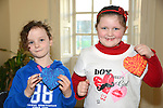 Alice Reynolds of Legavoureen Manor (left) and Joy Mooney from Oulster Lane show off their handiwork at the Valentine's Day Heart Art Workshop at the Droichead Arts Centre. Photo: Andy Spearman.