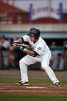 Burlington Bees second baseman Tim Arakawa (4) lays down a bunt during a game against the Clinton LumberKings on August 20, 2015 at Community Field in Burlington, Iowa.  Burlington defeated Clinton 3-2.  (Mike Janes/Four Seam Images)