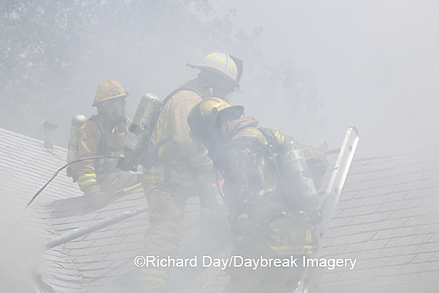 63818-021.04 Firefighters ventilating roof at house fire,  Marion Co. IL