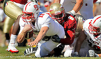 TALLAHASSEE, FL 10/29/11-FSU-NCST102911 CH-Florida State's Timmy Jernigan sacks N.C. State quarterback Tyler Brosius during second half action Saturday at Doak Campbell Stadium in Tallahassee. The Seminoles shut out the Wolfpack 34-0.COLIN HACKLEY PHOTO