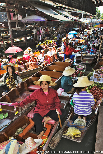The Damnoen Saduak Floating Market outside Bangkok is a colorful spot and a popular tourist attraction.