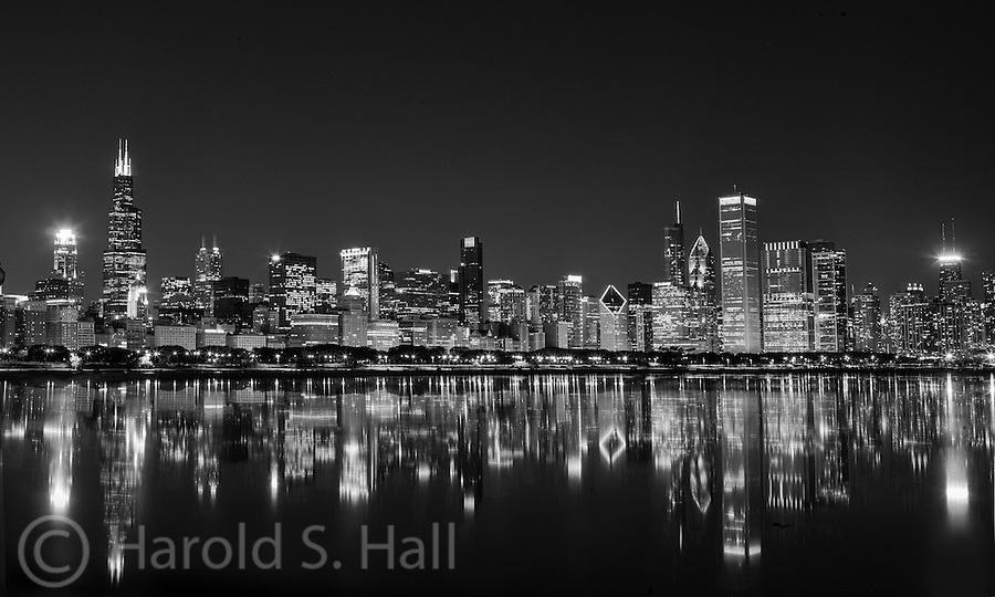 The great city of Chicago has a very impressive building and a great traditions of allowing varied and modern buildings.  This view of the Windy City is made all the more impressive by the great reflection of these impressive buildings.