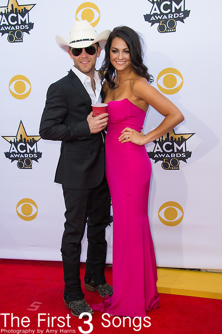 Justin Moore and Kate Moore attend the 50th Academy Of Country Music Awards at AT&T Stadium on April 19, 2015 in Arlington, Texas.