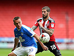 Kieron Freeman of Sheffield Utd gets close to Paul Taylor of Peterborough Utd  during the League One match at Bramall Lane Stadium, Sheffield. Picture date: September 17th, 2016. Pic Simon Bellis/Sportimage