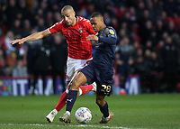 Elliot Simoes of Barnsley shields the ball from Charlton's Darren Pratley during Charlton Athletic vs Barnsley, Sky Bet EFL Championship Football at The Valley on 1st February 2020