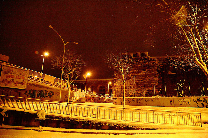 Urban view at the borders of the Pigneto quarter, in Rome, with ancient walls and arcs (the Felice aqueduct) on the background, in the very early morning after a snowing night (February, 2012). Digitally Improved Photo.