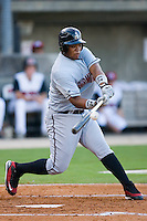 Dayan Viciedo #24 of the Birmingham Barons makes contact with the baseball against the Carolina Mudcats at Five County Stadium August 15, 2009 in Zebulon, North Carolina. (Photo by Brian Westerholt / Four Seam Images)