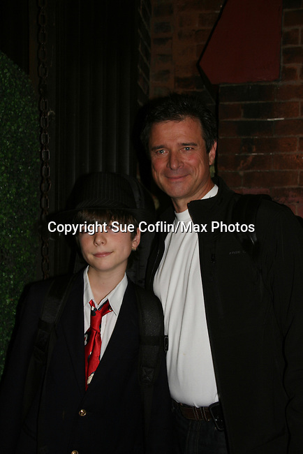 James DePaiva who stars in Under Fire, the musical - a part of the New York Musical Theatre Festival poses with son JQ on October 4, 2009 at The Theatre of St. Clements, New York City, New York. (Photo by Sue Coflin/Max Photos)