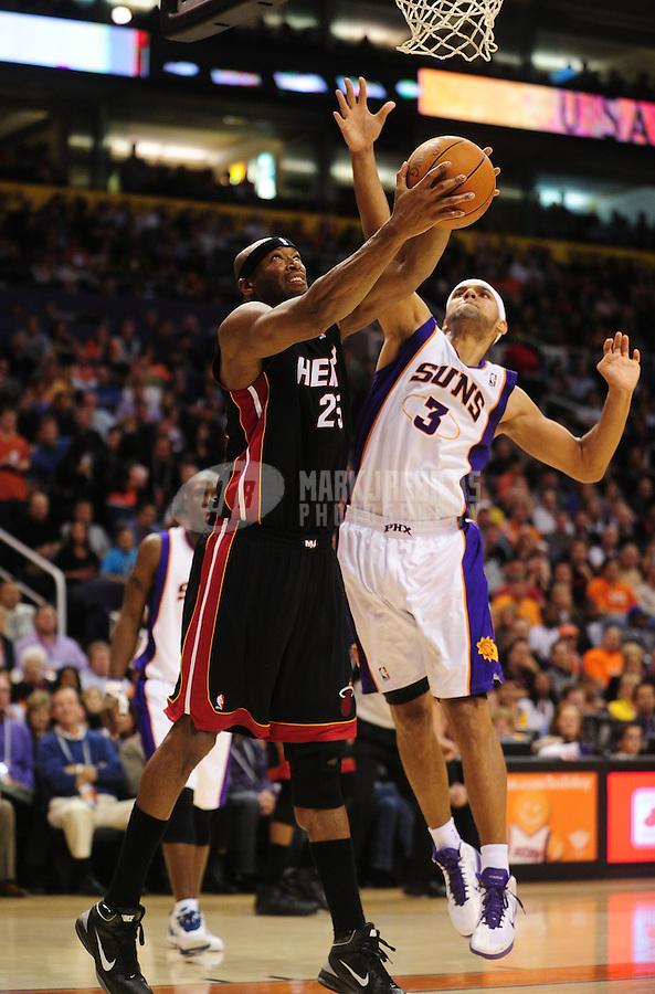 Dec. 23, 2010; Phoenix, AZ, USA; Miami Heat center (25) Erick Dampier shoots the ball under pressure from Phoenix Suns forward Jared Dudley at the US Airways Center. Mandatory Credit: Mark J. Rebilas-