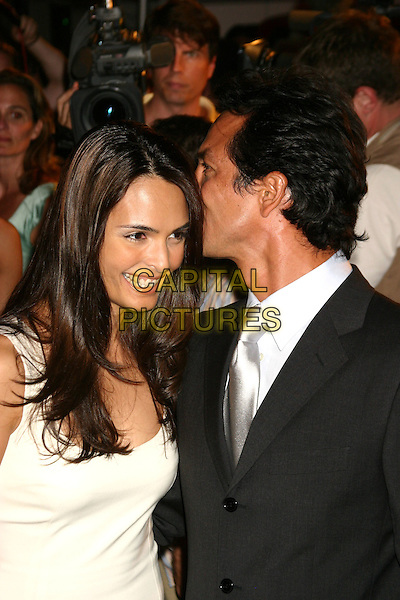 "TALISA SOTO & BENJAMIN BRATT.The Purr-fect Catwoman Merchandise Launch and After Party For The New York Screening Of ""Catwoman"" at Henri Bendel in New York . .July 21st 2004..half length white dress.Ref: IW.www.capitalpictures.com.sales@capitalpictures.com.©Capital Pictures."