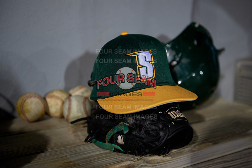 Siena Saints hat and glove on the bench during a game against the UCF Knights on February 14, 2020 at John Euliano Park in Orlando, Florida.  UCF defeated Siena 2-1.  (Mike Janes/Four Seam Images)