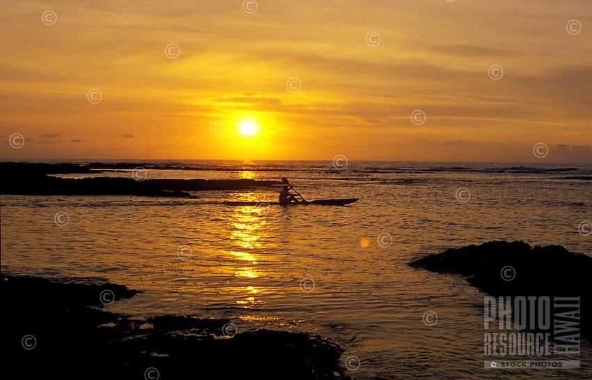 Man ocean kayaking enjoying the evening sunset