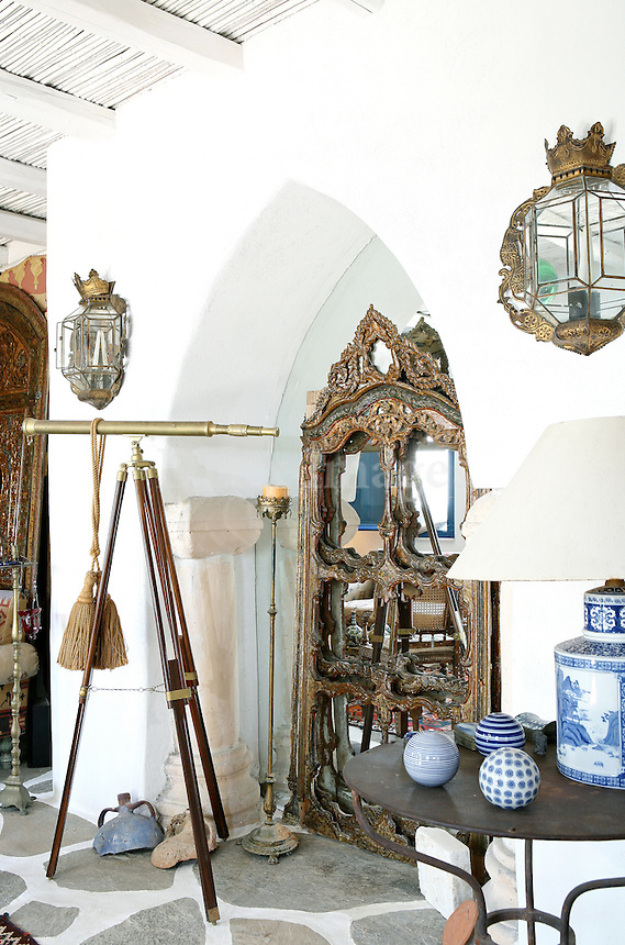 A retreat on the Greek island of  Paros. With the owner's  eclectic taste in art he chose rare sculptures in ..monumental sizes to fit exactly to the landscape where the house is situated. He also decorated the inside with antiquities mixed with custom made paintings and interesting objects from France. NO SALES IN FRANCE