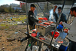 Men dine at a street barbecue stand in Ramallah, West Bank.