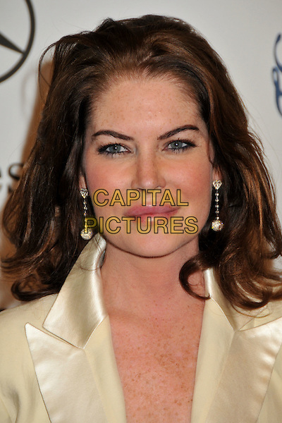 LARA FLYNN BOYLE .The 30th Annual Carousel Of Hope Ball at the Beverly Hilton Hotel, Beverly Hills, California, USA..October 25th, 2008.headshot portrait dangling gold earrings .CAP/ADM/BP.©Byron Purvis/AdMedia/Capital Pictures.
