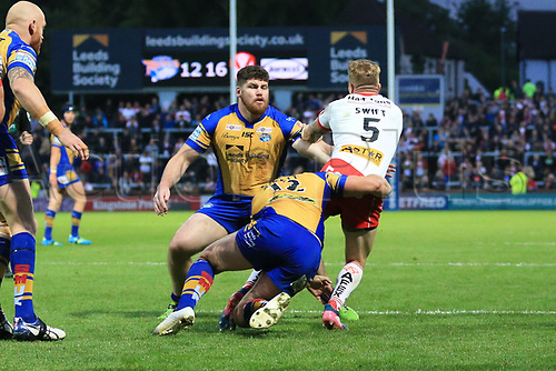 June 29th 2017, Headingley Carnegie, Leeds, England; Betfred Super League; Leeds Rhinos versus St Helens; Adam Swift of St Helens tackled by Carl Ablett of Leeds Rhinos