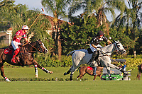 WELLINGTON, FL - DECEMBER 31:  Most Valuable Player Matt Coppola (black helmet), being chased by Coca Cola's Sugar Erskine (white helmet), controls the ball down the field, in the Tackeria's 12-11 win in the Herbie Pennell Cup Final, at the International Polo Club Palm Beach, on December 31, 2017 in Wellington, Florida. (Photo by Liz Lamont/Eclipse Sportswire/Getty Images)