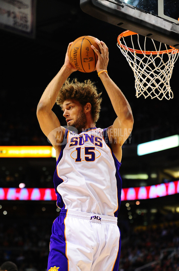 Jan. 28, 2011; Phoenix, AZ, USA; Phoenix Suns center (15) Robin Lopez against the Boston Celtics at the US Airways Center. Mandatory Credit: Mark J. Rebilas-