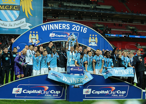 28.02.2016. Wembley Stadium, London, England. Capital One Cup Final. Manchester City versus Liverpool. Manchester City Defender and Captain Vincent Kompany raises the Capital Cup Trophy, and celebrates with his team