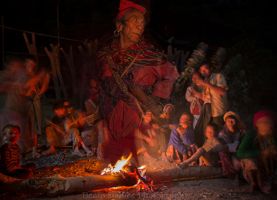 Shaman dancing around the fire in the Chin Hills, Myanmar