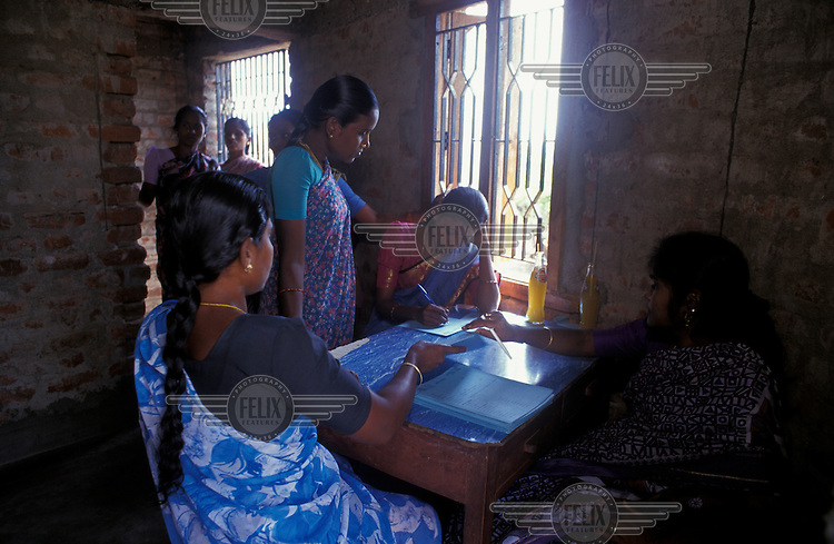 Outreach staff of a reproductive healthcare NGO check referral forms to their clinic after a day providing health checks and contraceptive advice to villagers.