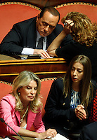 Il leader del PdL Silvio Berlusconi, in alto a sinistra, ascolta la senatrice Paola Pelino durante la discussione sulla mozione di sfiducia nei confronti del Ministro dell'Interno e Vicepresidente del Consiglio al Senato, Roma, 19 luglio 2013. In basso, le senatrici del PdL Maria Rizzotti, sinistra, e Mariarosaria Rossi.<br /> People of Freedom (PdL) party's leader Silvio Berlusconi listens to Senator Paola Pelino, right, during a plenary session for the discussion of a no confidence motion against Interior Minister and Deputy Premier, at the Senate in Rome, 19 July 2013. At bottom, PdL Senators Maria Rizzotti, left, and Mariarosaria Rossi<br /> UPDATE IMAGES PRESS/Riccardo De Luca
