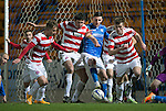 St Johnstone v Hamilton Accies...04.01.15   SPFL<br /> Michael O'Halloran is crowded out by Martin Canning and Michael Devlin<br /> Picture by Graeme Hart.<br /> Copyright Perthshire Picture Agency<br /> Tel: 01738 623350  Mobile: 07990 594431