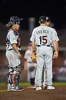 Tri-City ValleyCats pitching coach Drew French (15) talks with pitcher Howie Brey (36) as catcher Gabriel Bracamonte (24) listens during a game against the Auburn Doubledays on August 25, 2016 at Falcon Park in Auburn, New York.  Tri-City defeated Auburn 4-3.  (Mike Janes/Four Seam Images)