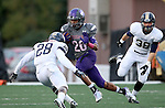 SIOUX FALLS, SD - OCTOBER 4: John Tidwell #26 from the University of Sioux Falls looks to make a move past Marc St. Louis #28 from Concordia St. Paul in the first half of their game Saturday evening at Bob Young Field.(Photo by Dave Eggen/Inertia)