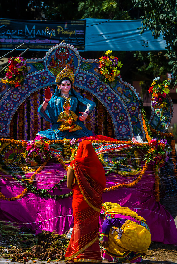The figure of Holika a top a pire during the Holika Dahan in Mathura. These pires will be burnt all over Mathura on Purnima (full moon) the night before Holi; Mathura, Uttar Pradesh, India.